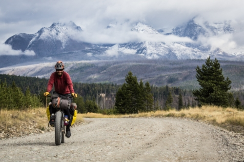 Dave Biking with Glacier National Park Behind
