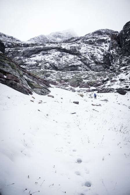 Grete Climbing Towards Gunsight Pass